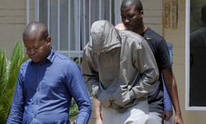 South Africa's Olympic sprinter Oscar Pistorius leaves the Boshkop police station in Pretoria