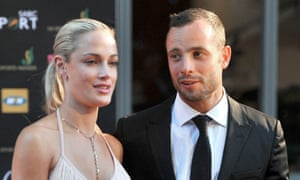 Oscar Pistorius and his model girlfriend Reeva Steenkamp during the Feather Awards in Johannesburg on November 4, 2012 AFP PHOTO / Lucky NxumaloLUCKY NXUMALO/AFP/Getty Images
