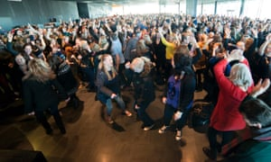 An estimated 1500 dance together in Reykjavik's Harpa's Music Hall.