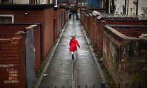 Child runs down alleyway