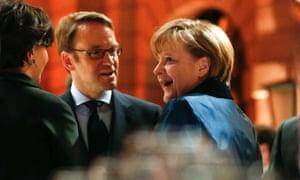 German chancellor Angela Merkel talks with president of the German Bundesbank Jens Weidmann last month.