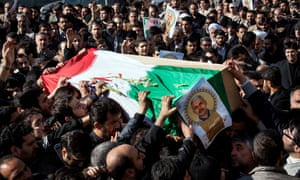 Iranians carry the coffin of Commander Hassan Shateri, who was shot dead while he was travelling by road in Syria towards the Lebanese capital. =