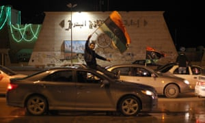 Libyans wave the national flags from their vehicles, during a celebration in Benghazi, Libya, Friday, Feb. 15, 2013. Libya is closing its borders and tightening security ahead of the second anniversary of the start of the revolution that toppled Moammar Gaddafi.