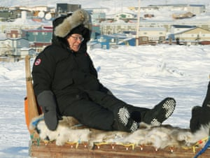 Governor of the Bank of England Mervyn King riding on a dog sled on the outskirts of northern community of Iqaluit, Canada, for the G7 meeting in 2010.