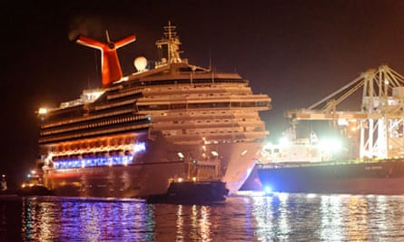 Carnival Triumph is towed towards the docks in Mobile, Alabama,
