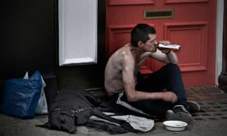 Homeless drinker with dog