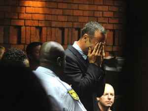 Oscar Pistorius weeps in court in Pretoria, South Africa at his bail hearing in the murder case of his girlfriend Reeva Steenkamp.
