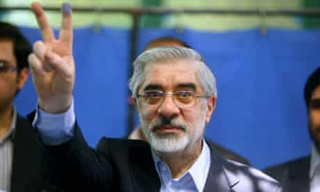 Iranian opposition leader Mir Hossein Mousavi flashes the V sign after voting in the 2009 elections