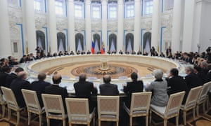 Vladimir Putin speaks to G20 finance chiefs in the Kremlin in Moscow today. Can you match the back of the head to the country?