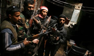 Members of the Free Syrian Army hold their weapons in the old city of Aleppo.