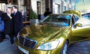 France's finance minister Pierre Moscovici and Britain's chancellor George Osborne (2nd L) walk past a wedding car at the Ritz Carlton hotel in Moscow. Photograph: Reuters/Sergei Karpukhin