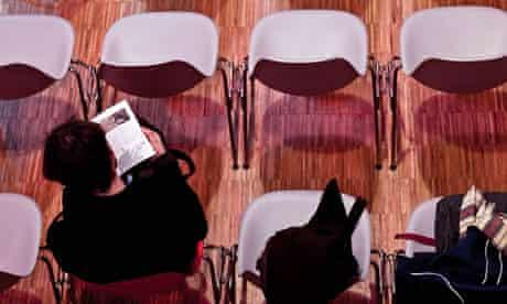 A man reading a concert programme
