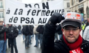 PSA Peugeot Citroen workings demonstrating in Paris yesterday against plant closures and job losses. Photograph: AFP/Getty Images/Loic Venance