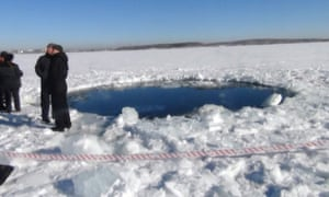 CHELYABINSK REGION, RUSSIA - FEBRUARY 15: A hole in the Chebarkul Lake made by meteor fragments on February 15, 2013 in Chelyabinsk, Russia. A meteor shower hit Russia's Chelyabinsk region today (FRI) injuring around 1000 people.  PHOTOGRAPH BY ITAR-TASS / Barcroft Media  UK Office, London. T +44 845 370 2233 W www.barcroftmedia.com  USA Office, New York City. T +1 212 796 2458 W www.barcroftusa.com  Indian Office, Delhi. T +91 11 4053 2429 W www.barcroftindia.com