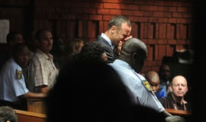 20 Photos: Oscar Pistorius breaks down during his court appearance in Pretoria