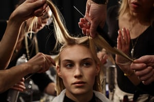 20 Photos: In New York, a model has her hair styled before the Kaufmanfranco show