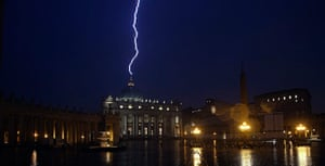 20 Photos: A flash of lighting is seen over St.Peter's Basilica at Vatican