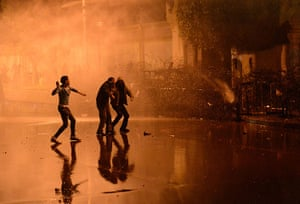 20 Photos: Egyptian security use water cannon as protesters throw stones in Cairo