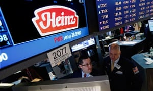 Traders work at the post that trades HJ Heinz Co on the floor of the New York Stock Exchange