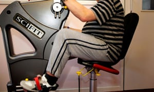 A man sitting at an exercise machine