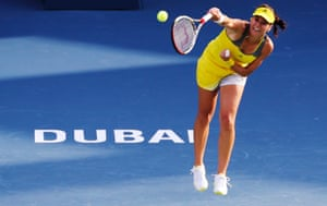 Sorana Cirstea of Romania serves to Sloane Stephens of the U.S. during their women's singles match at the WTA Dubai Tennis Championships.