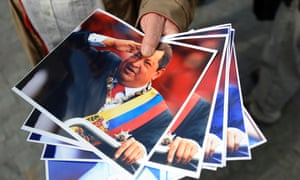 A vendor sells pictures of Venezuelan President Hugo Chavez as his supporters gather at Simon Bolivar Square in Caracas to celebrate after Chavez announced on Twitter that he had returned to the country from Cuba and is hospitalized at a military hospital in the Venezuelan capital.