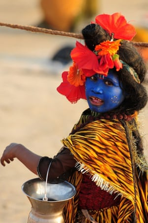 The blue boy: dressed as Lord Shiva, a boy during the Kumbh Mela festival in Allahabad, India.