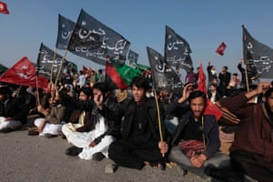 Shi'ite Muslims hold flags while demonstrating against Saturday's bombing, during a protest in Islamabad. Pakistani Shi'ites furious over a sectarian bombing that killed 89 in Quetta, protested on Monday, demanding that security forces protect them from hardline Sunni groups.