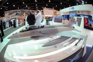 A model of a fighter aircraft is displayed at an exhibition stand during the International Defence Exhibition and Conference (IDEX) at the Abu Dhabi National Exhibition Centre.