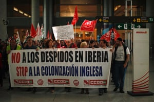 "Iberia workers protest during a strike at Pablo Ruiz Picasso Airport in Malaga, southern Spain February 18, 2013. The banner reads, ""No to layoffs in Iberia. Stop the British colonization"", and the sign reads, ""28 years of protecting Iberia's policies, and now B.A. (British Airways)""."