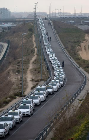 A long line of taxis wait for passengers at Barajas international airport in Madrid, Spain. Flights were disrupted Monday as workers at Iberia airlines began the first of 15-days of strikes to protest the company's plan to cut almost a fifth of its workforce.