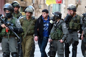 Israeli security forces arrest a Palestinian protester, during clashes that erupted following a demonstration supporting the Palestinian prisoners in Israeli jails, in the West Bank city of Hebron.