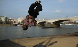 A man practices his parkour on the South Bank in London.