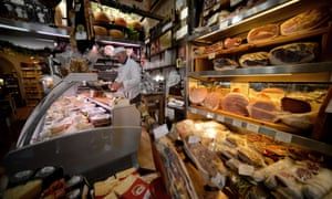 A man works in his grocery shop in downtown Rome. The future of Italy's economy and the social costs of austerity have taken centre stage as Italians prepare to go to the polls next week.