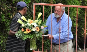 Barry Steenkamp, Reeva's father, receives flowers from well-wishers in Port Elizabeth, South Africa.