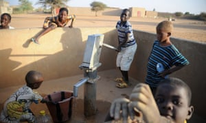 Children pump water in northern Mali's city of Gao. Brussels today announced a major international conference on the country's future. Photograph: Pascal Guyot/AFP/Getty Images