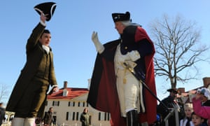 Dean Malissa (right), playing the role of George Washington, is welcomed by David Kozisek, who plays Washington's personal secretary Tobias Lear, as he arrives for a celebration to mark President's Day at Washington's Mount Vernon estate in Alexandria, Virginia.