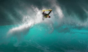 A bodyboarder is launched from the crest of a wave on the Banzai Pipeline, off Ehukai Beach Park in Hawaii.