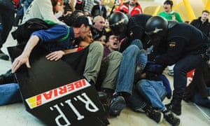Workers for Spanish airline Iberia clash with baton-wielding police at Madrid-Barajas airport last night.