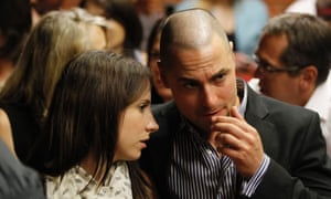 Oscar Pistorius's sister Aimee and brother Carl await the start of court proceedings in the Pretoria magistrate's court on 19 February 2013.