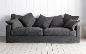 Homes - From Dawn to Dusk: sofa against a white wall with beige floor