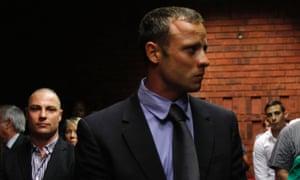 Oscar Pistorius awaits the start of court proceedings on 19 February 2013.