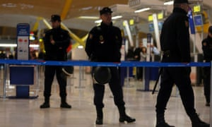 Riot police officers stand guard at the British Airways check-in area.