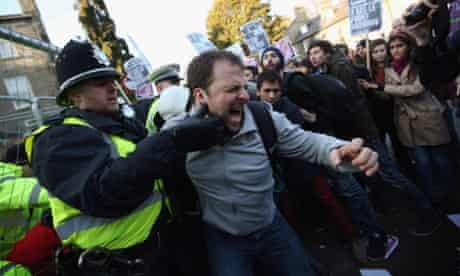 Protesters clash with police outside Cambridge University's student union as Marine Le Pen, the leader of the French far-right Front National party, prepares to address the Union's debating society in Cambridge, England.