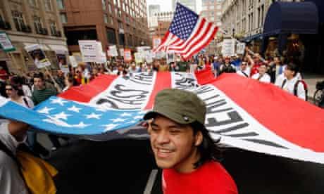 Carlos Saavedra leads demonstrators in Boston