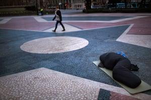 24 hours: A demonstrator sleeps in  Catalunya square
