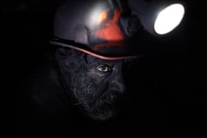 24 hours: A miner takes a short break inside an unregulated coal mine in Sabinas
