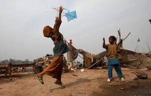 24 hours: Girls try to fly their kite on the outskirts of Lahore