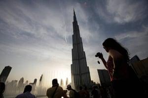 24 hours: Tourists take photographs of Burj Khalifa