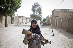 24 hours: A Malian soldier patrols in the streets